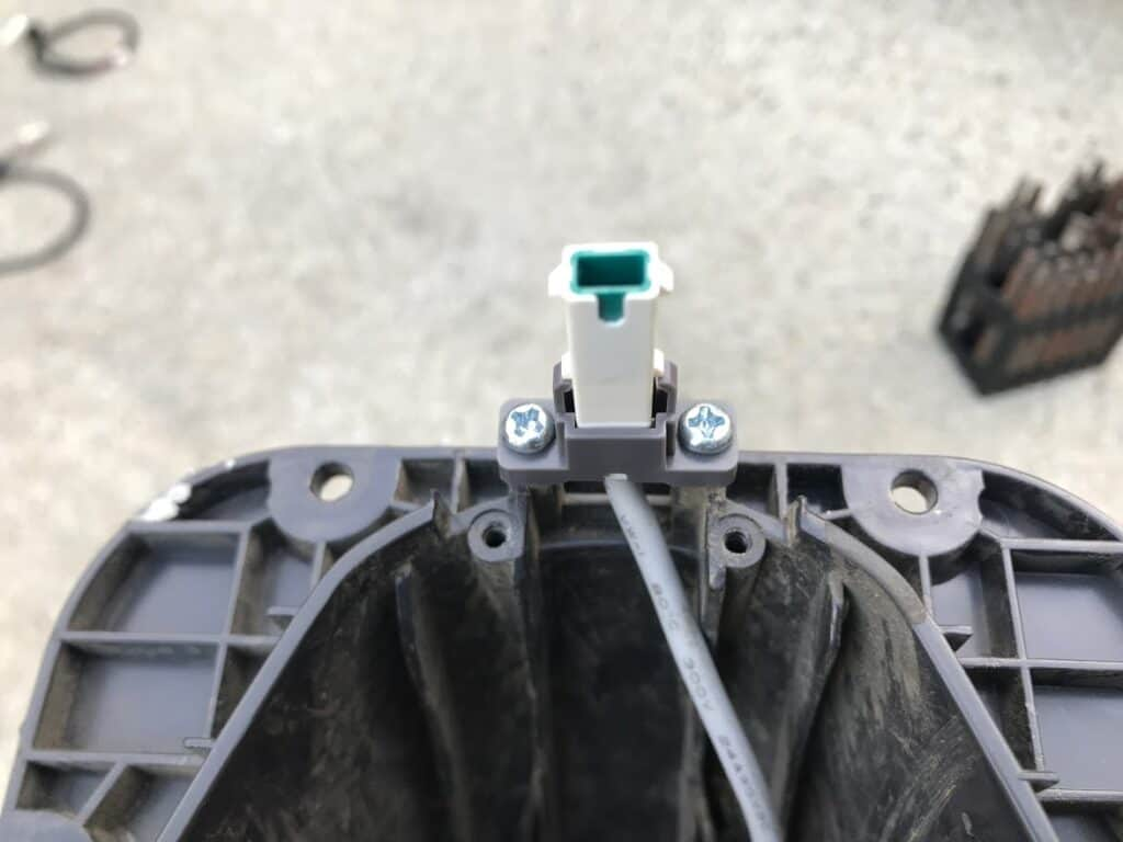 The connector reattached to the fender.