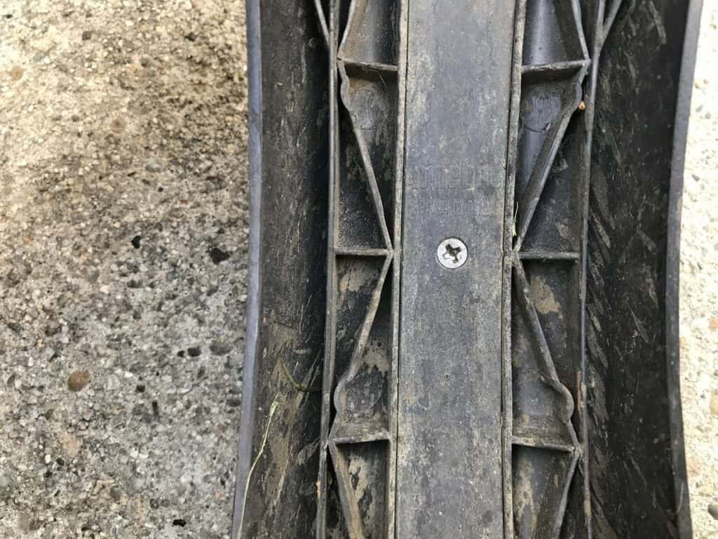 The flat screw holding the center down.